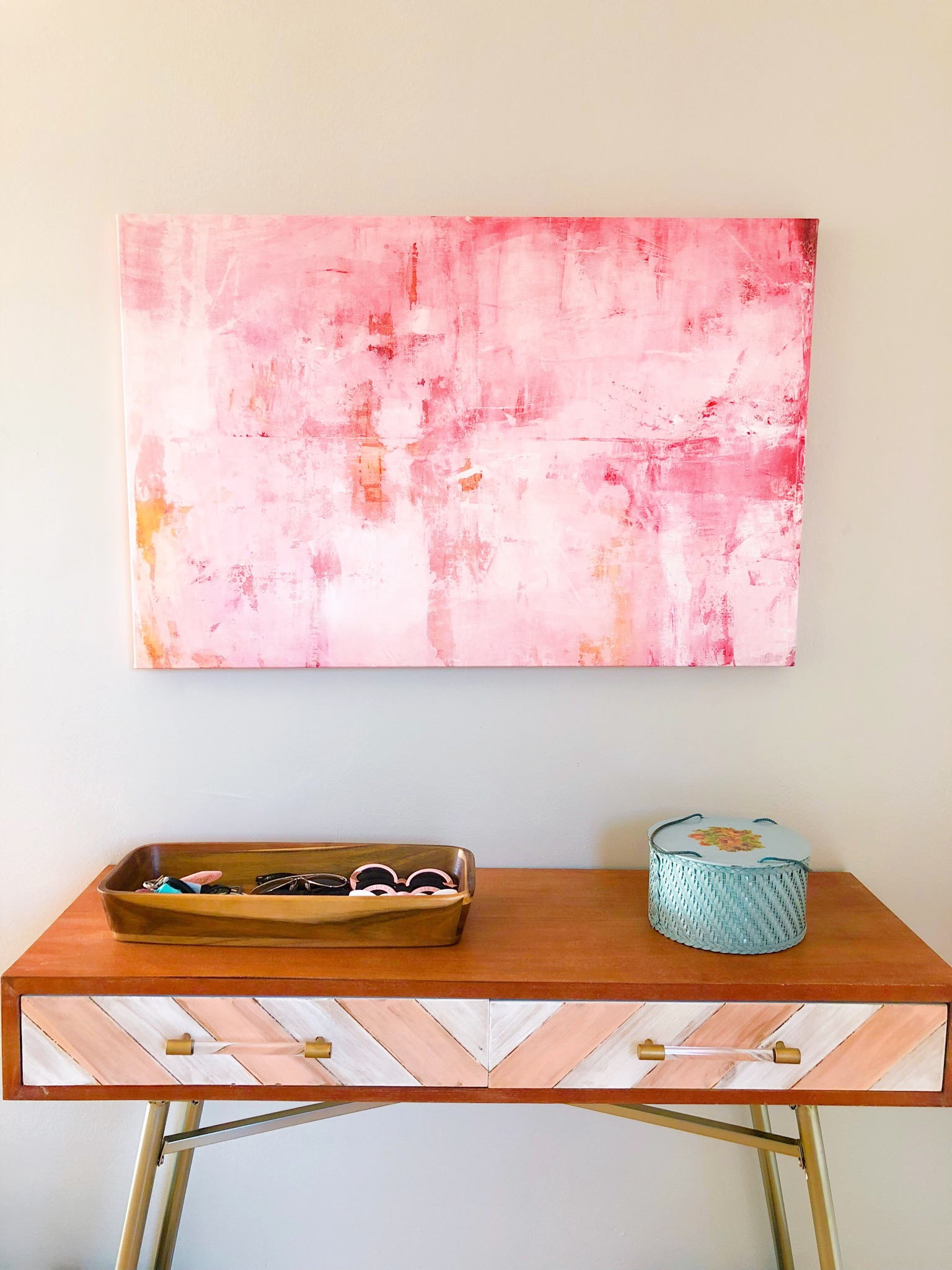 Michelle Oppenheimer's Pink Mirrors above Jenna's end table