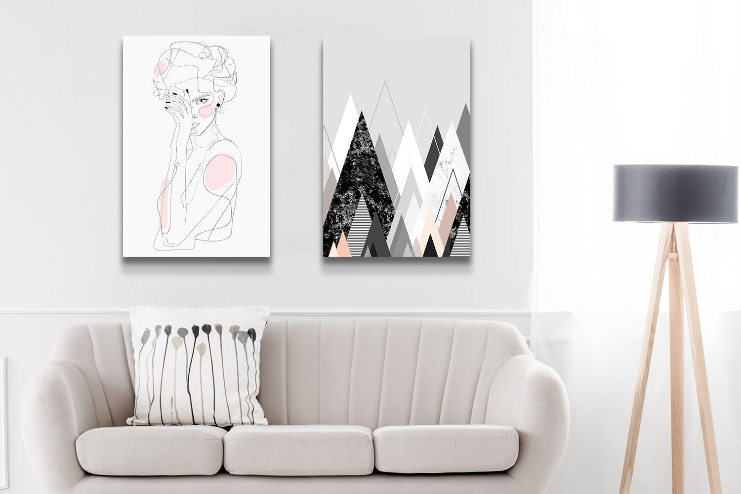 """A greige living room with two minimalist, neutral canvas art prints above the sofa: """"Freaq Sista"""" by Nettsch and """"Graphic CXXIV"""" by Marieke Böhmer"""