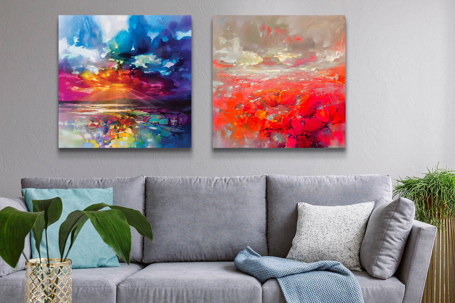 """A grey living room with two canvas art prints by Scott Naismith above a grey sofa: """"Sun's Energy"""" and """"Molecular Bonds"""""""