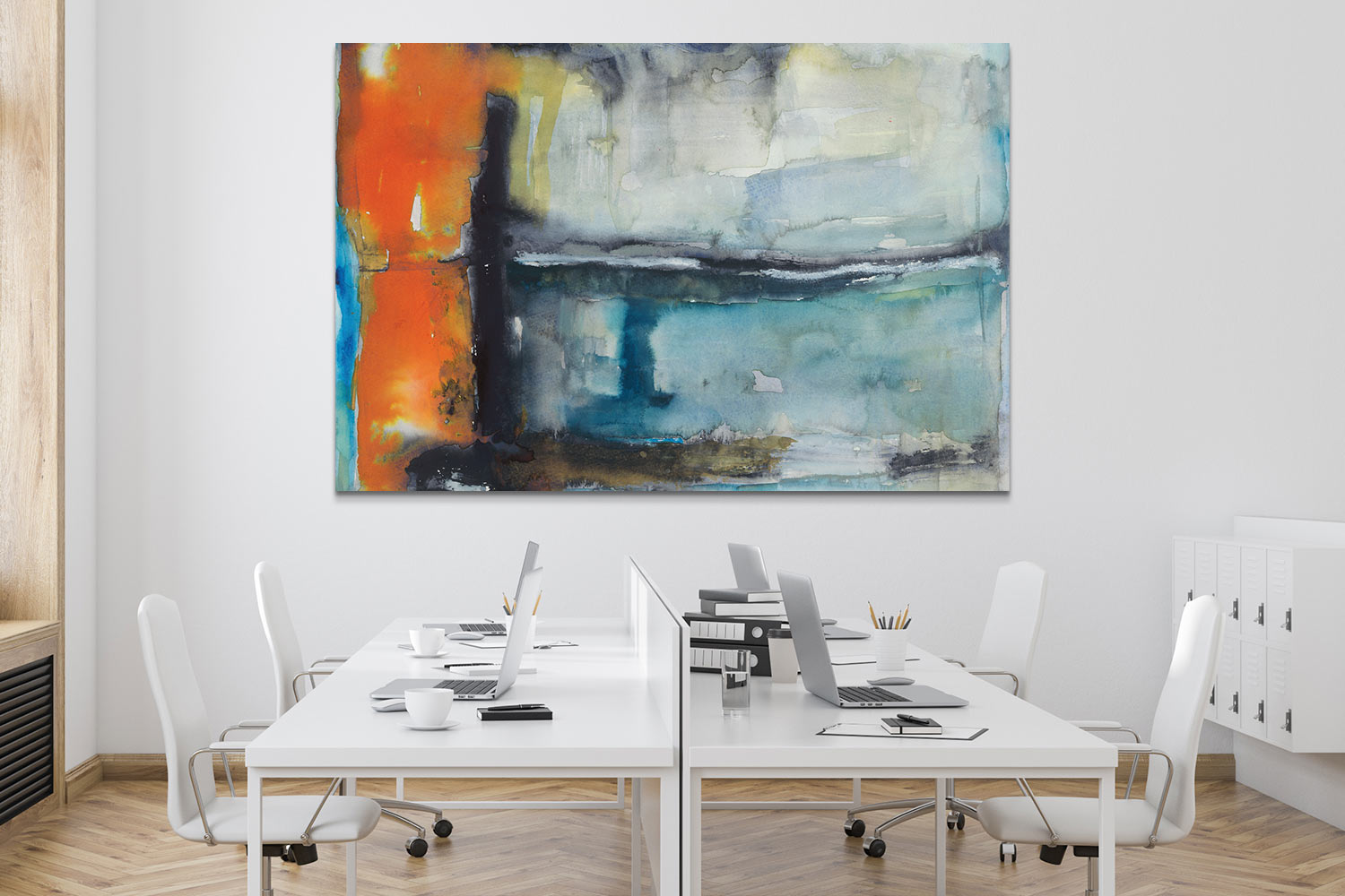 """A white, open office with canvas art print """"Surge"""" by Michelle Oppenheimer above desks"""