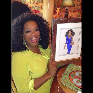 Oprah posing with her custom Hayden Williams portrait.