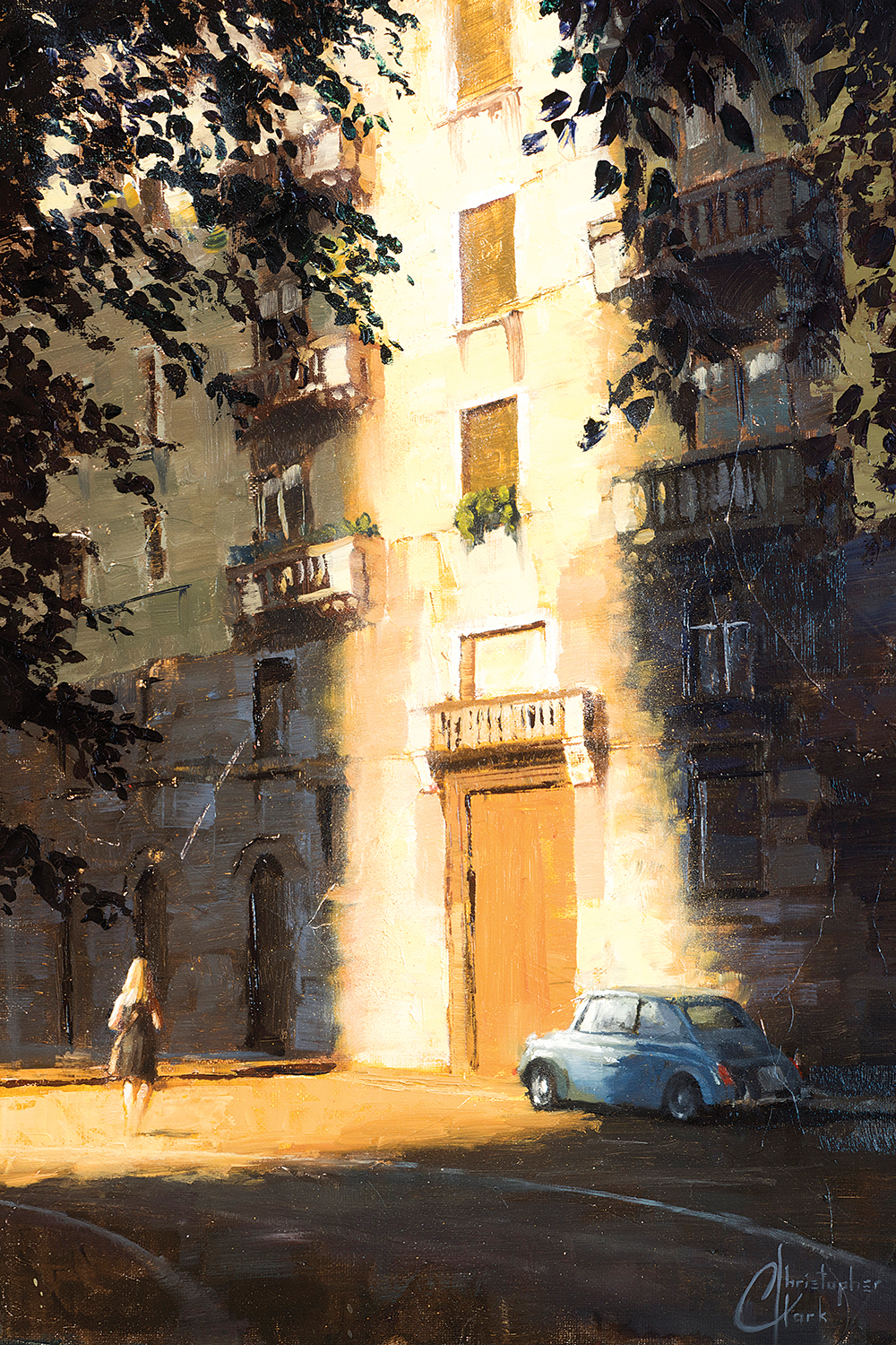 an apartment building in both sunlight and shadow and a woman walking towards it