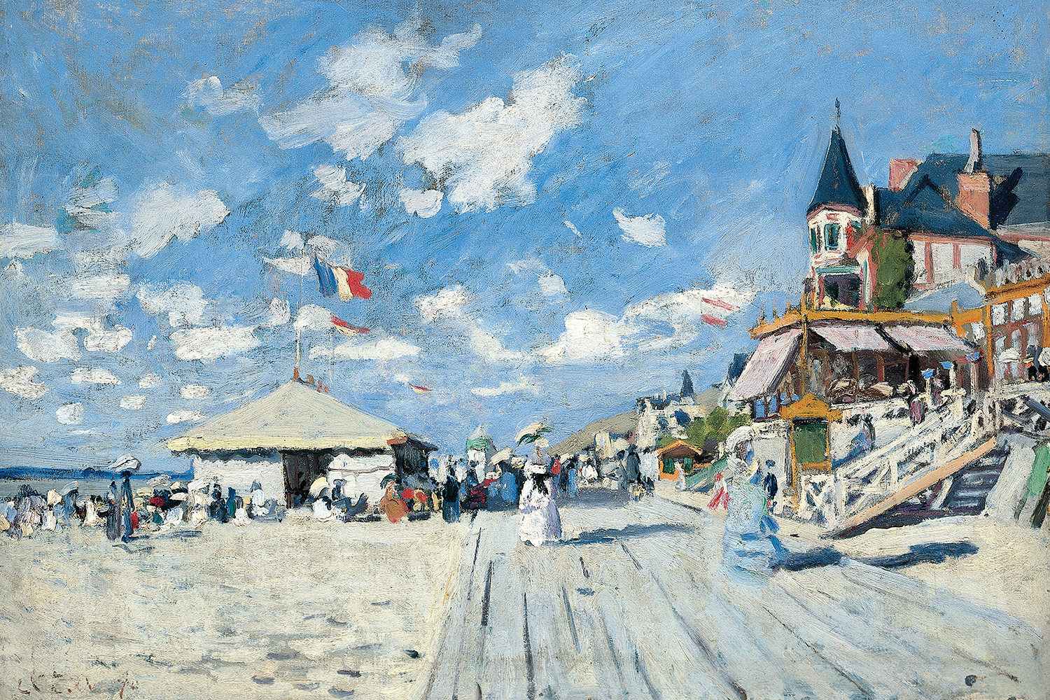 boardwalk along the beach showing tents, houses, and passerbys