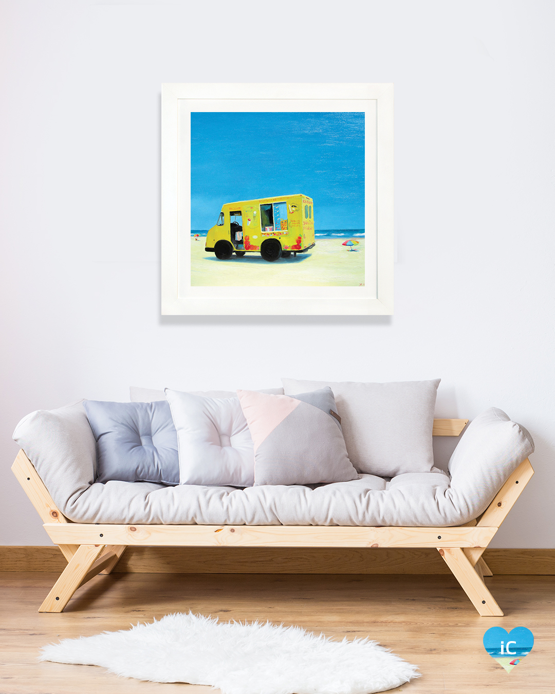 yellow ice cream truck parked on beach with water in view
