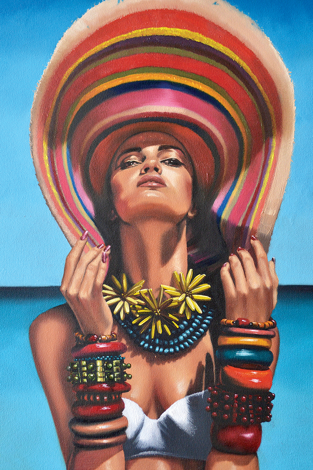 woman wearing large colorful sun hat, oversized necklaces, many bracelets, and white bathing suit top in front of blue