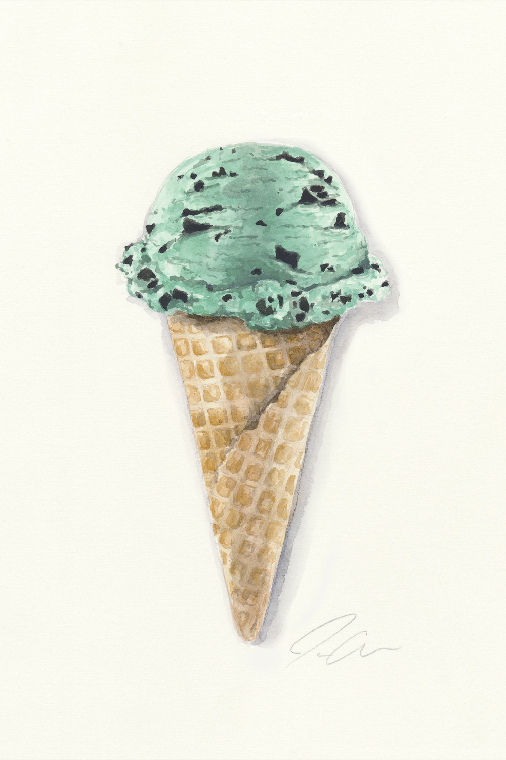 a single scoop of mint chocolate chip ice cream in waffle cone