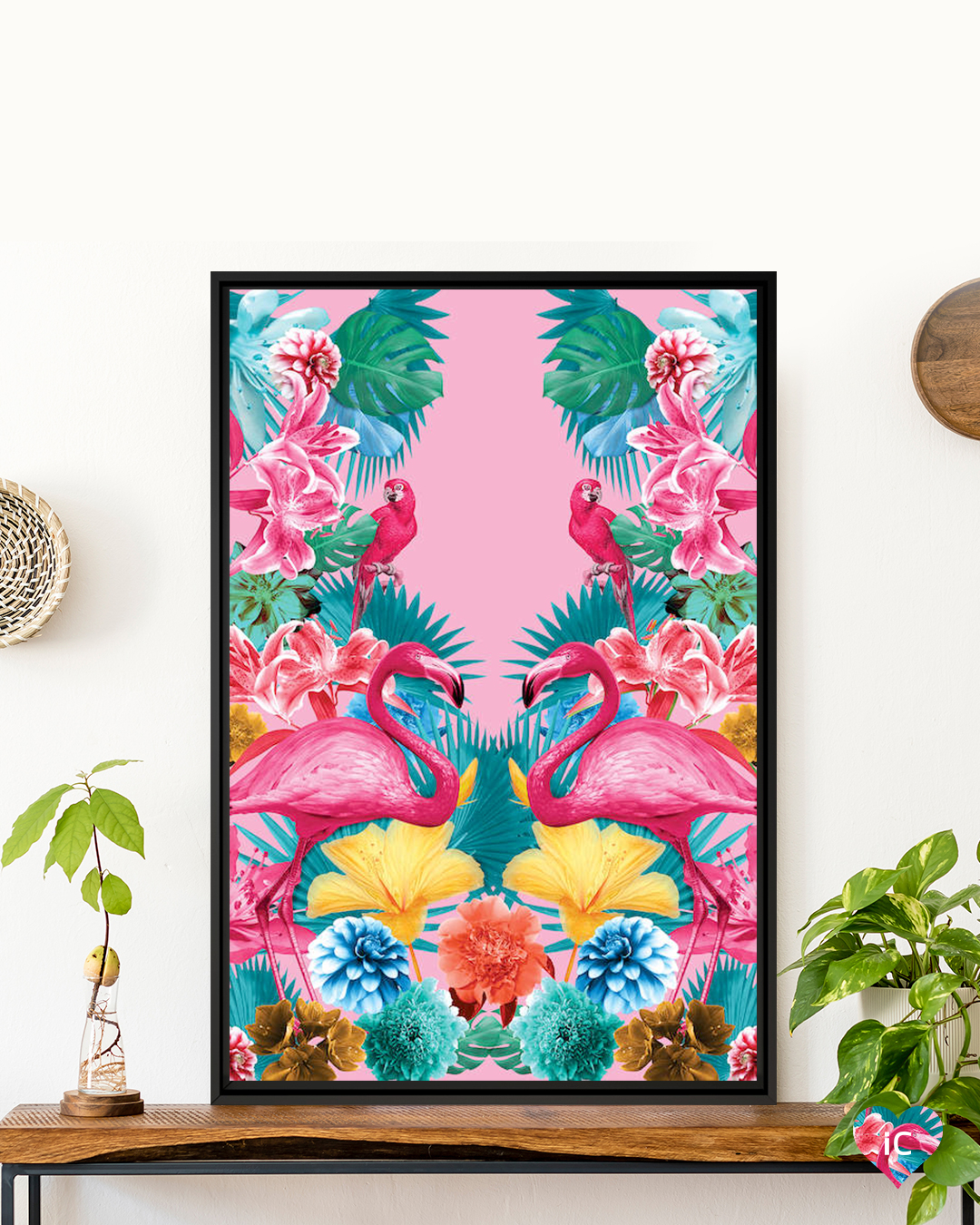 a bright pink symmetrical print featuring flowers, flamingos, and parrots