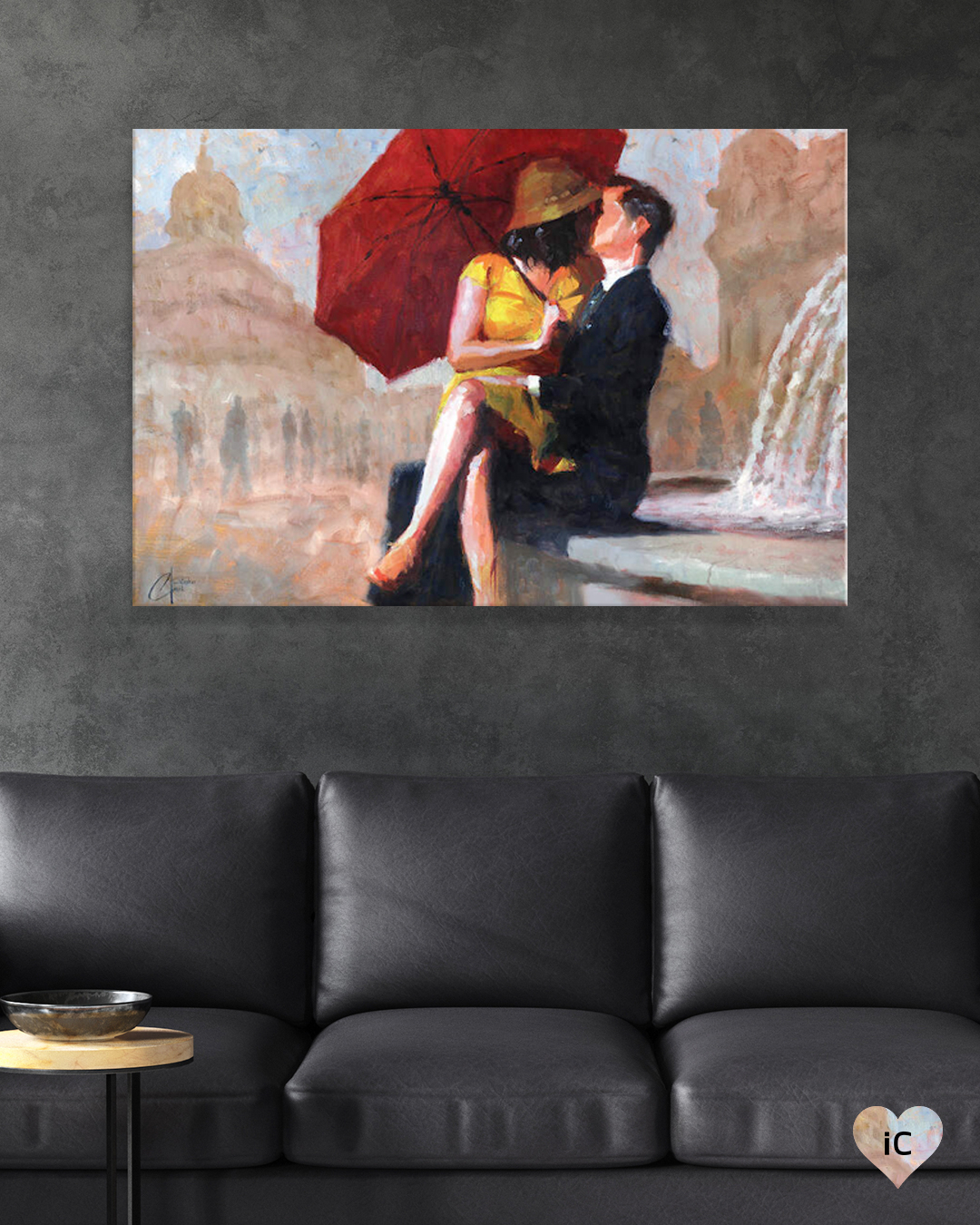woman holding a red umbrella wearing a yellow dress and hat sitting on man who's wearing a suit's lap while kissing near a fountain