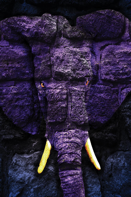 a purple elephant made out of rocks