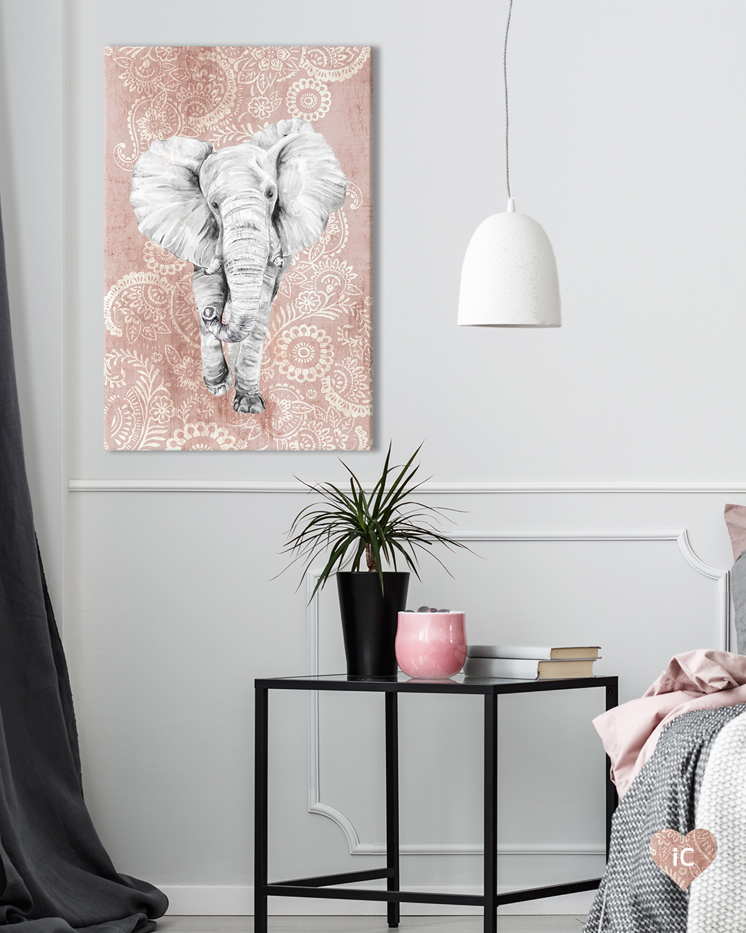 a large gray elephant walking towards you on a pink paisley background