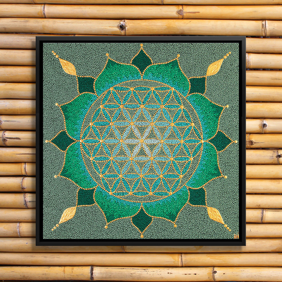 a green mandala flower featuring blue and gold