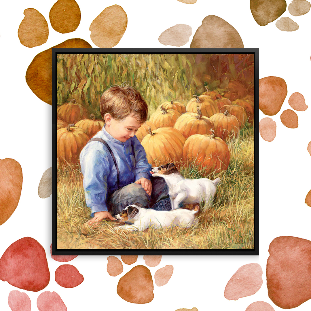 Little boy and two terrier puppies playing in a pumpkin patch during autumn