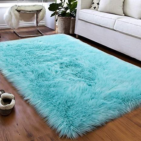 Light blue shaggy faux sheepskin area rug