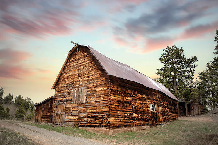 Photo of wood barn under a dusky sky