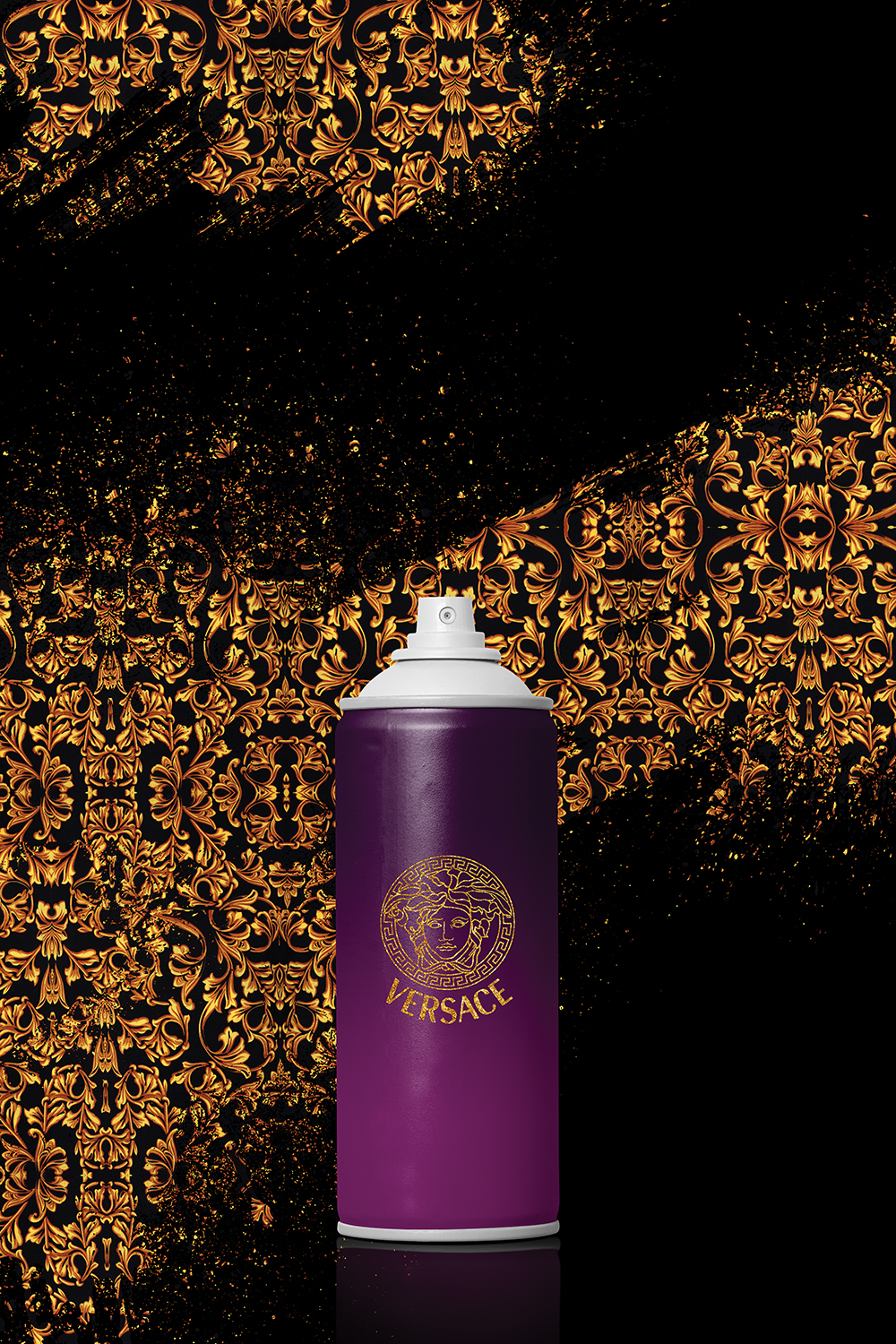 Graphic of a purple spray can with Versace logo on front on a black background sprayed with gold Versace pattern
