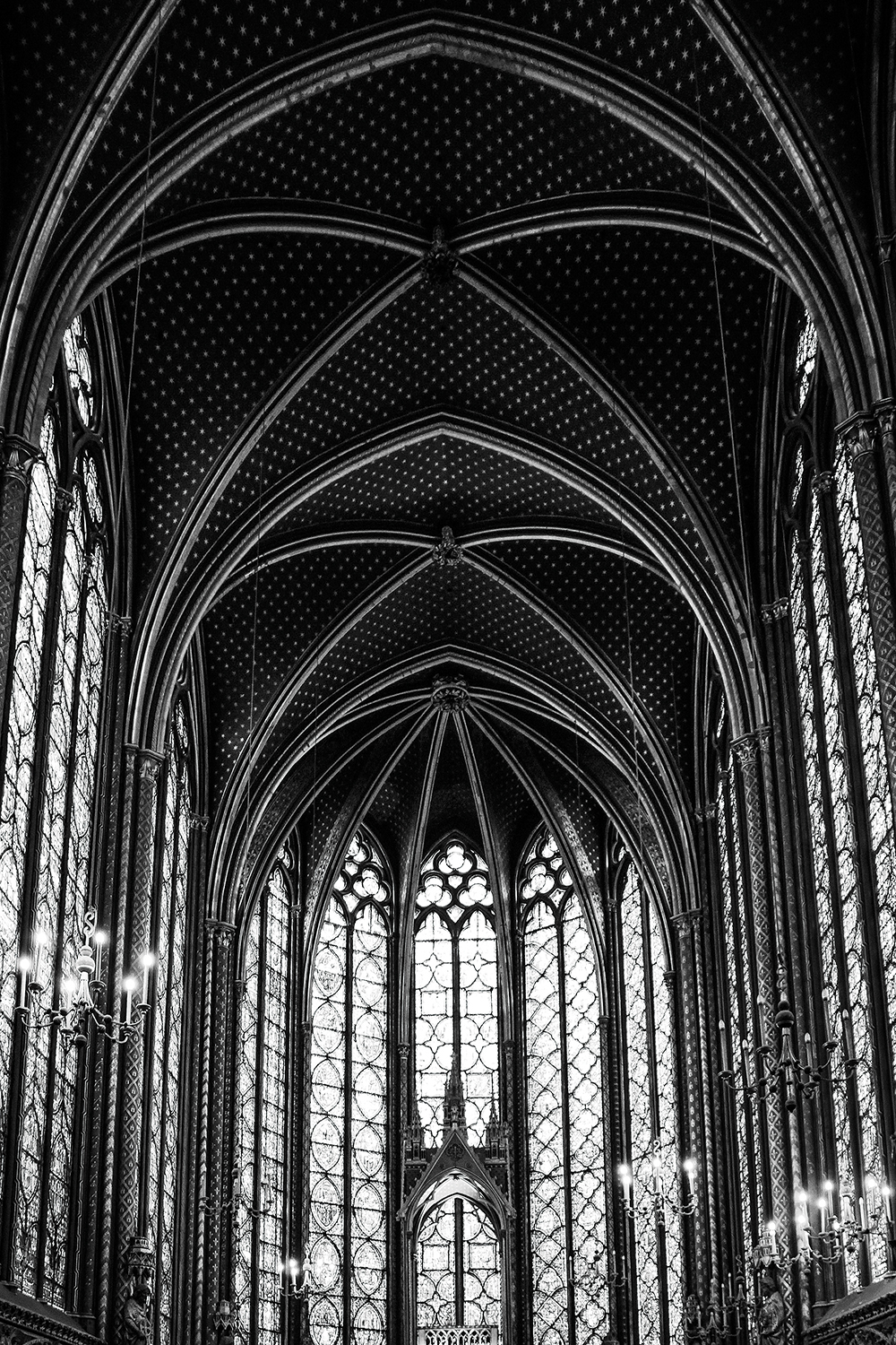 Black and white photo of the vaulted ceiling of a Gothic cathedral