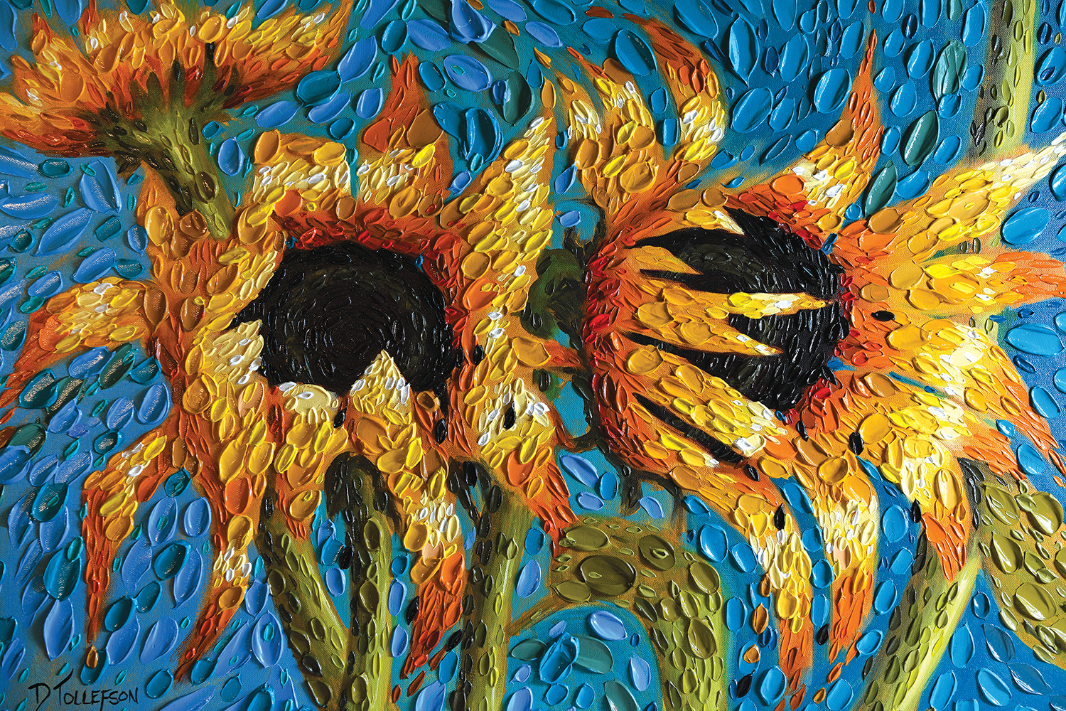Three large sunflowers on blue background with texture