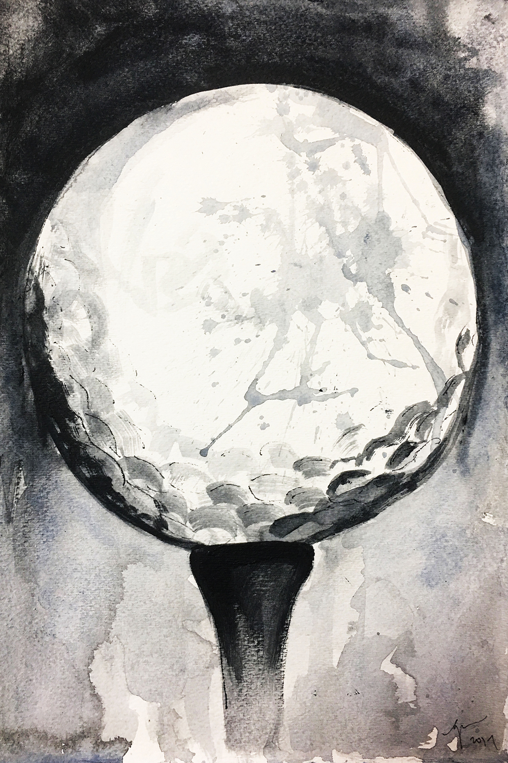 black and white close-up of a golf ball on a tee