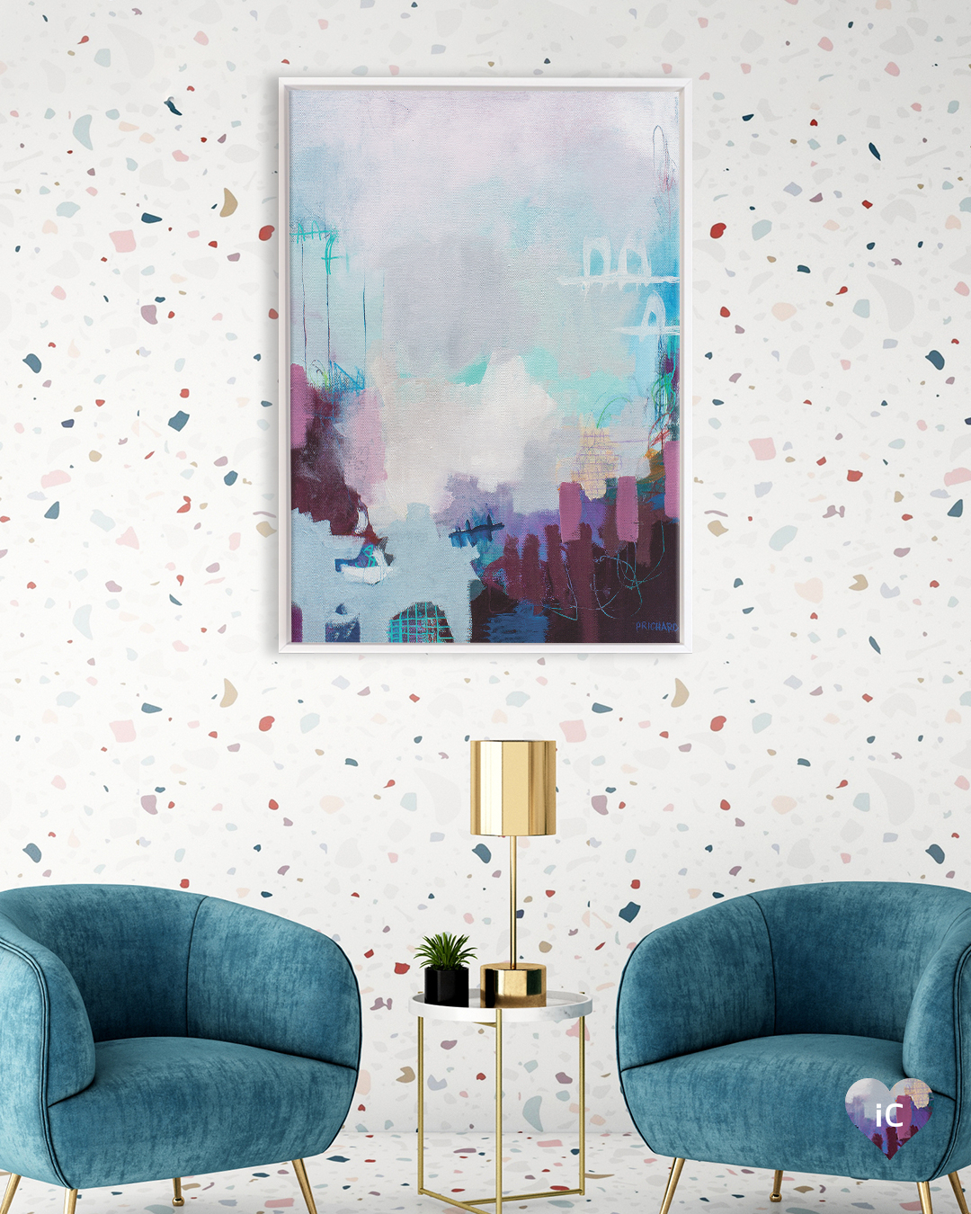 Abstract image in dark purple, blue, light blue, white and pink, framed in white on a terrazzo patterned wall in a room with two blue chairs