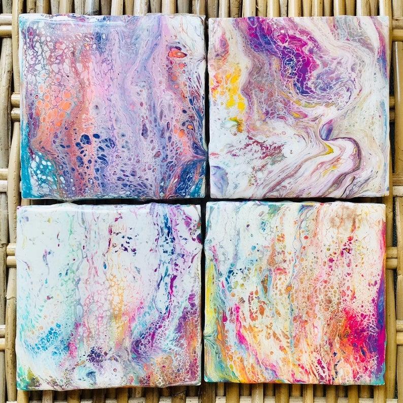Four square coasters with bright multi-colored resin design