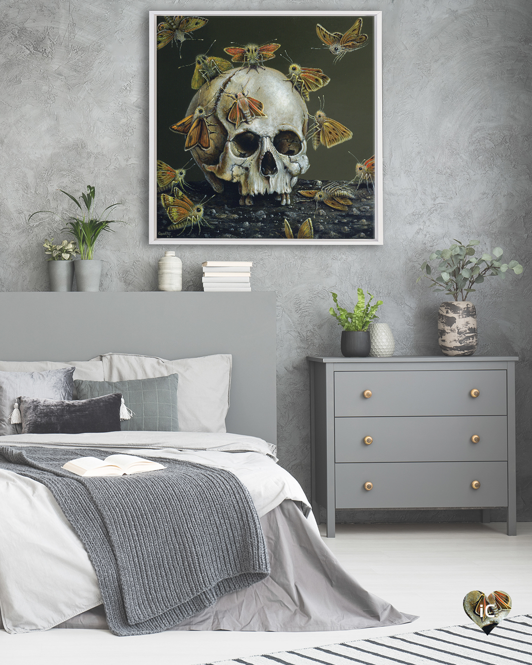 Skull surrounded by butterflies in a white frame on a gray wall in a bedroom with gray decor