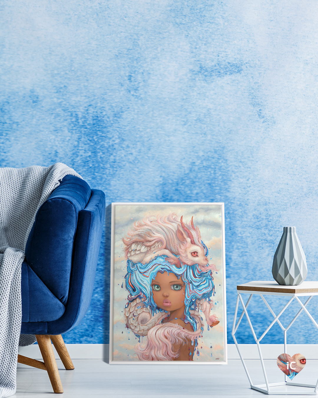 Pop surrealist portrait of girl with dripping blue hair and a pink creature on her head framed in white leaning on floor of a living room with a blue textured wall and a dark blue velvet sofa