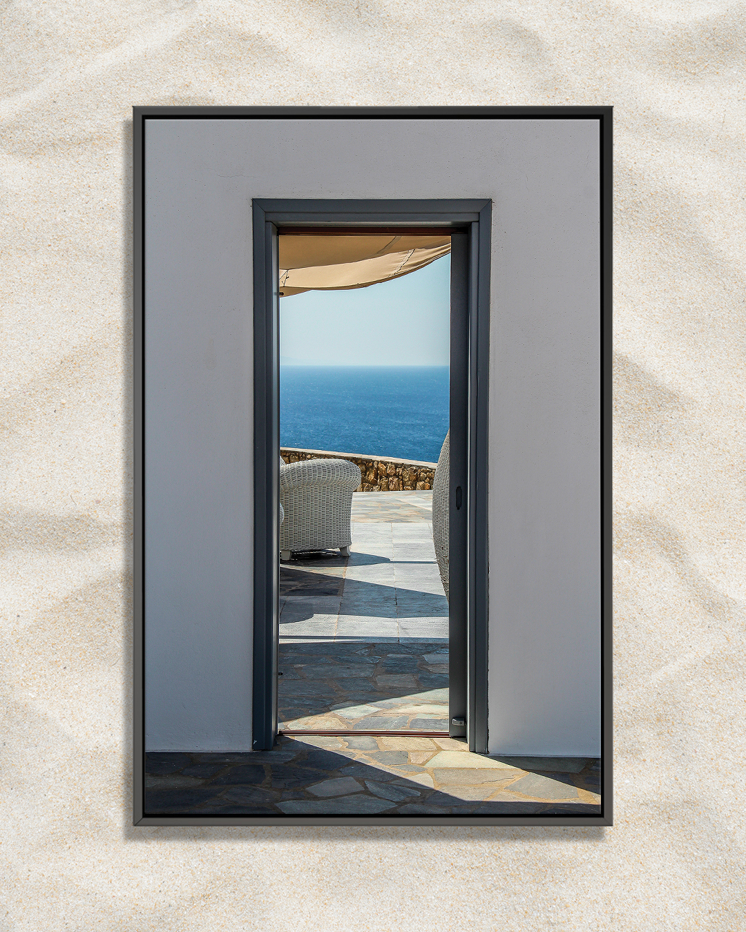 Photo of a view of balcony overlooking ocean in Mykonos through a doorway