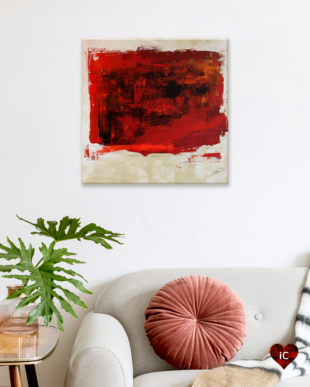 Abstract image of red square on beige background hanging on wall in modern living room