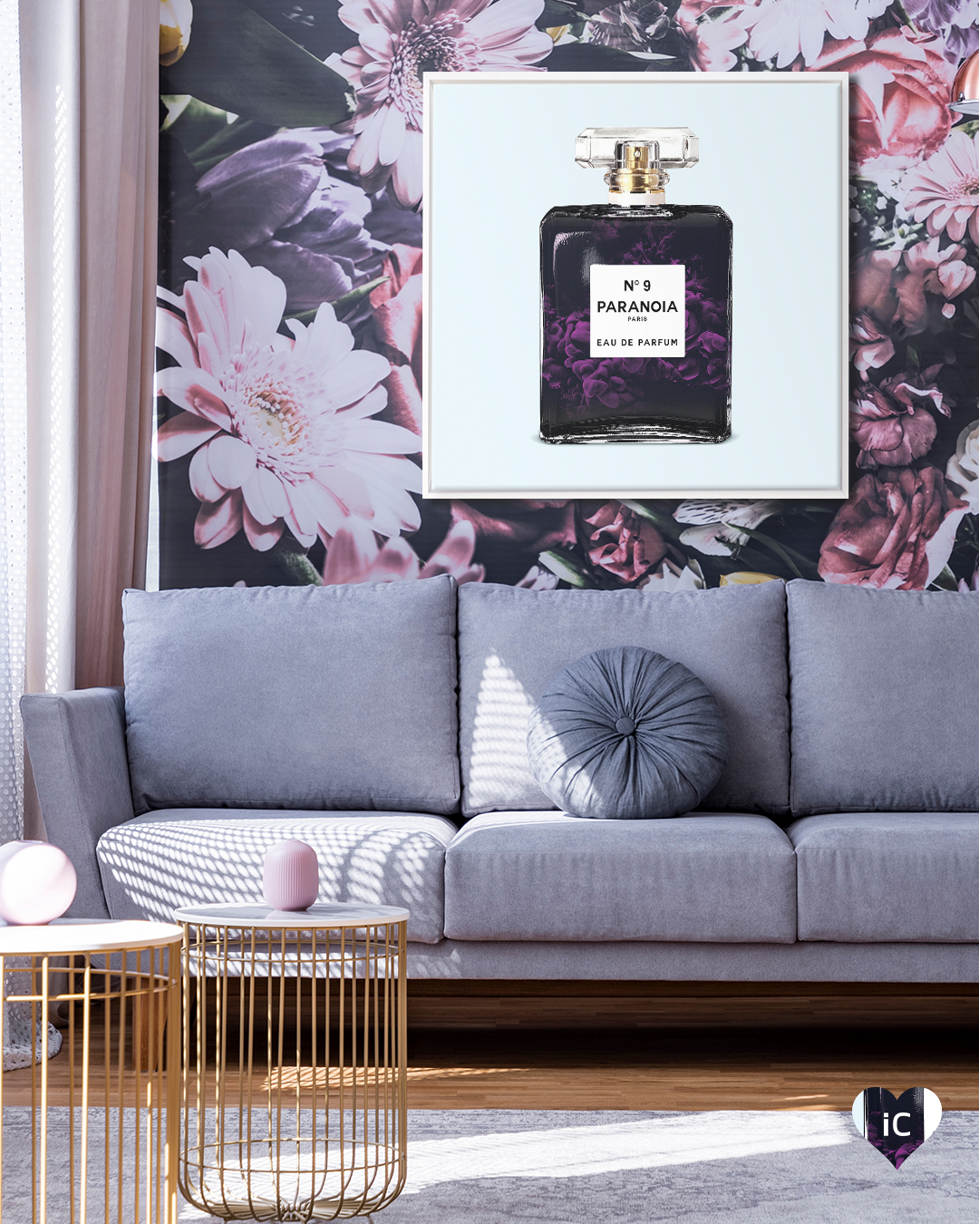 "Parody of Chanel perfume that says ""Paranoia"" on a light blue background framed in white in a room with floral wallpaper and a gray sofa"