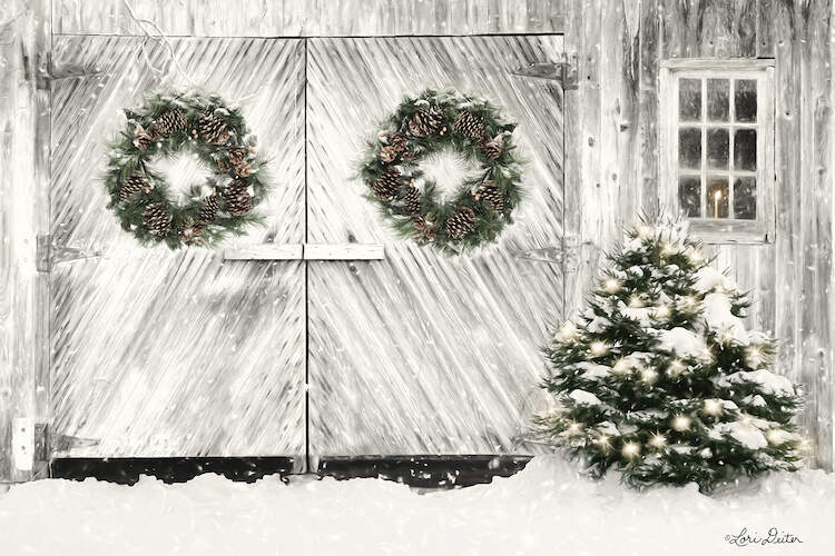 Double white barn doors with a Christmas wreath hanging on each door with snow falling next to a window with a lit candle inside of it and a bush with string lights next to the doors