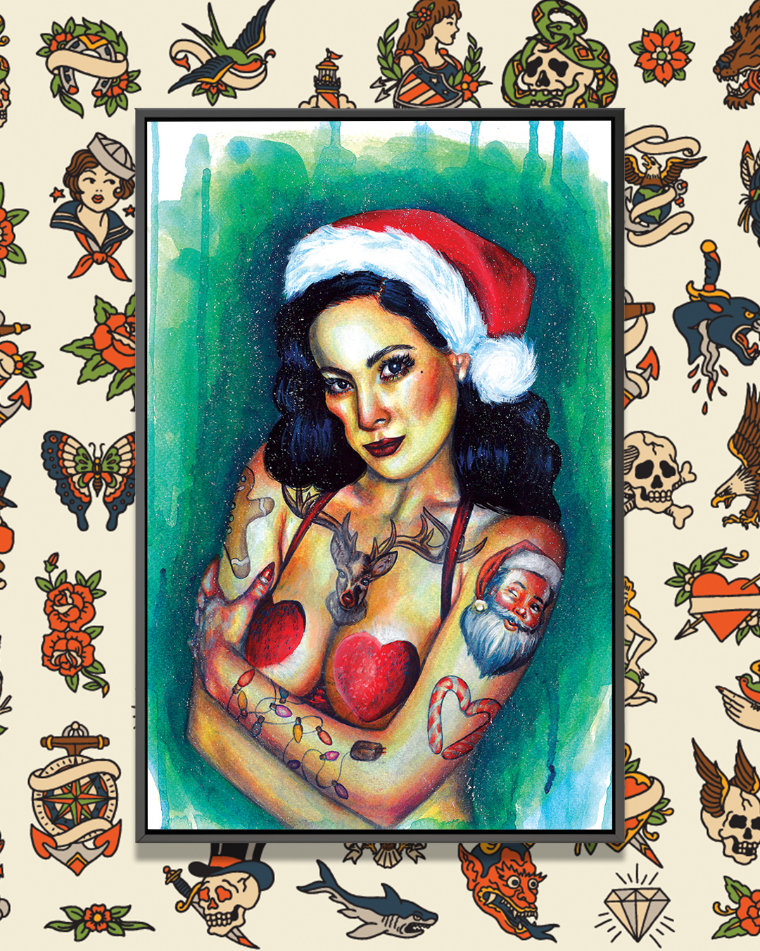 Dark haired female wearing a Santa hat and a red heart shaped bra with Christmas tattoos on her arms