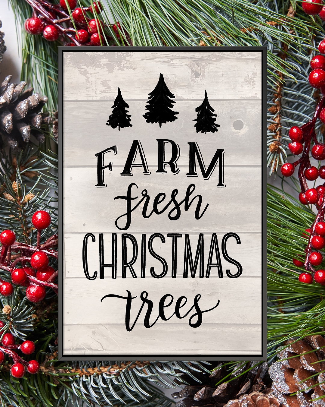 "Gray shiplap sign that says ""Farm Fresh Christmas Trees"" with outlines of three black trees with a black frame"