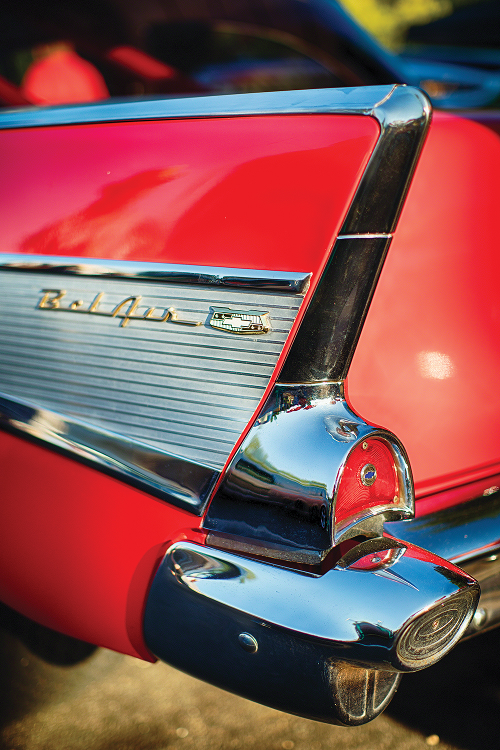 Photo of the rear end tail fin of a red Chevy Bel Air