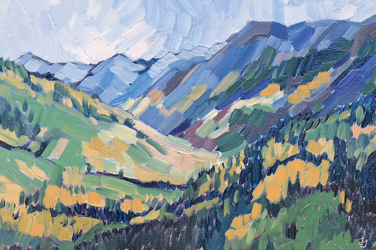"""Gold In The Mountains"" by Jessica Johnson shows mountains under a blue sky teeming with green and golden trees."