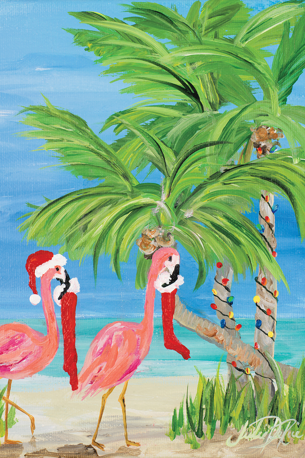Two pink flamingos wearing Santa hats and carrying stockings by a palm tree with Christmas lights wrapped around it on a beach
