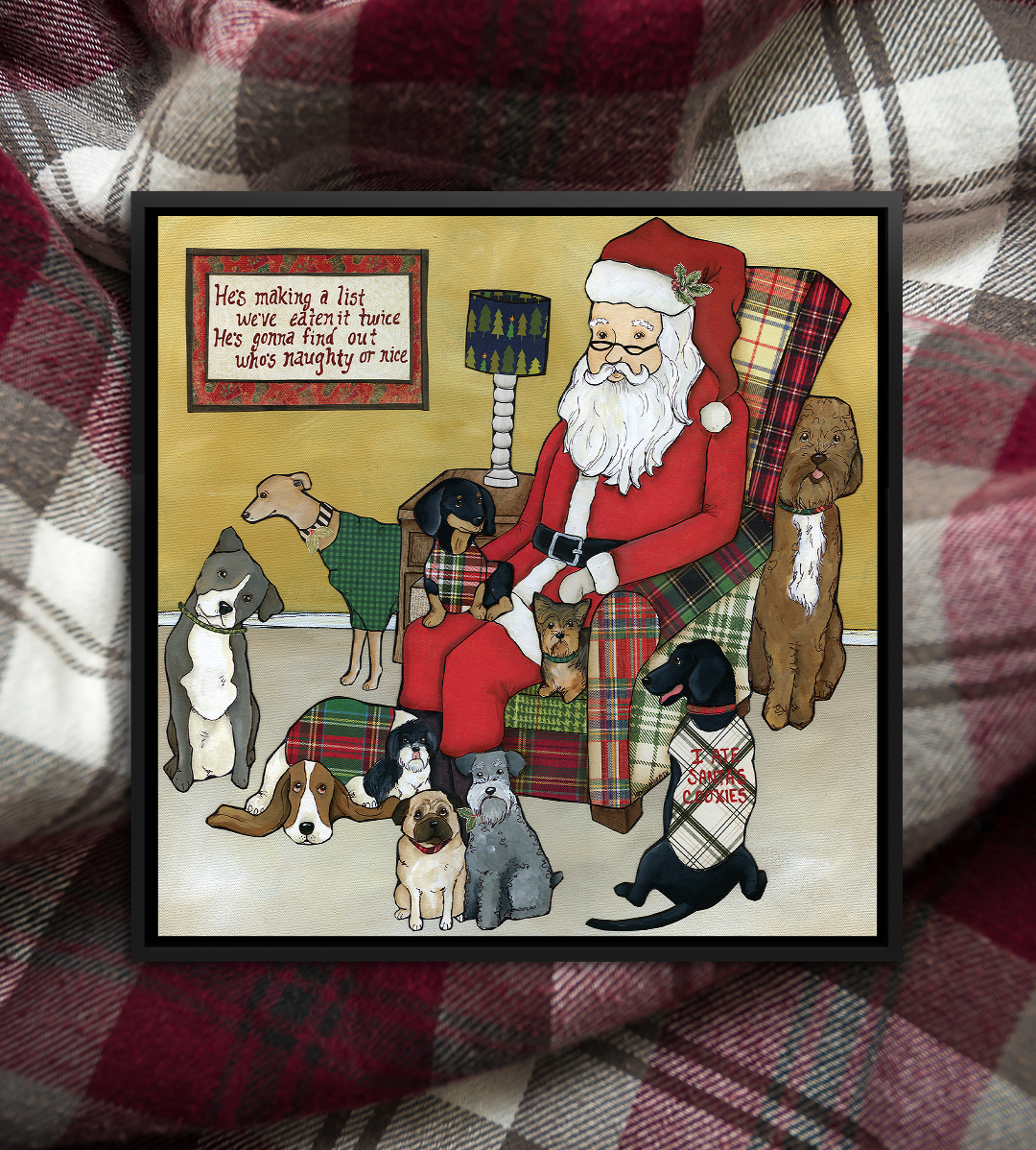 Santa sitting on a plaid chair with a group of dogs sitting around him