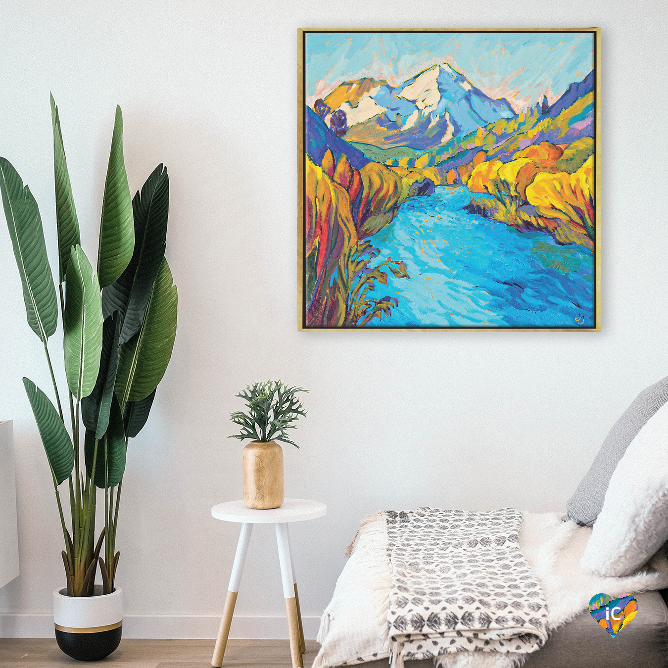 """River Mountain"" by Jessica Johnson shows a blue stream running through green and yellow banks with a mountain in the distance."