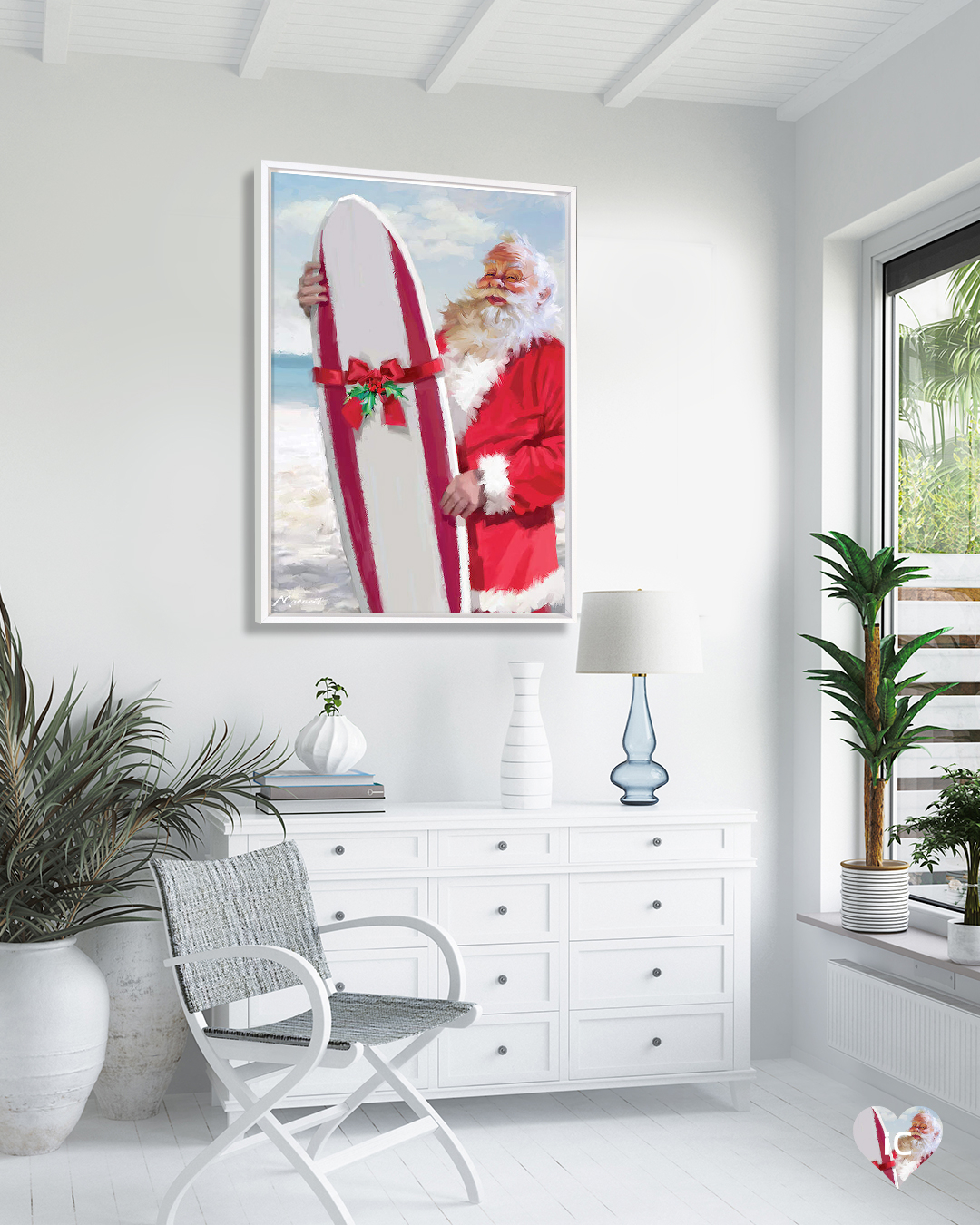 Print of Santa holding a red and white surfboard with a bow on it standing on the beach in a white coastal room with palm plants