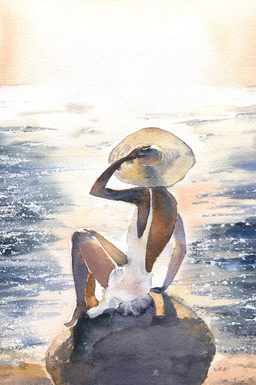 Backside view of a woman wearing a sun hat and a white dress sitting on a rock on a beach near the shore line under a bright sun