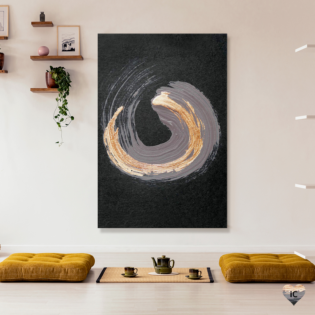 An abstract circular paint brush stroke layered in a deep purple gray and metallic gold on a black background, on a wall in an Asian-inspired room with mats and a tea set on the floor