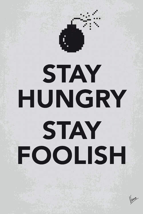 """Gray print with black text that says """"Stay Hungry Stay Foolish"""" by a pixelated bomb icon over it"""