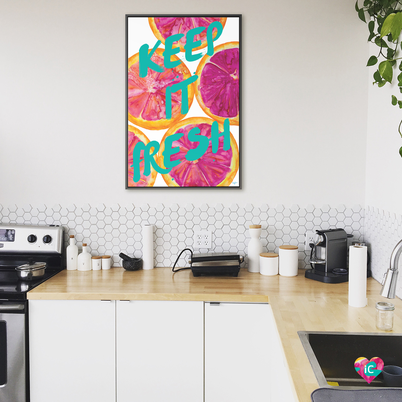 """""""Fresh & Sweet I"""" by Nola James shows the words 'keep it fresh' written in blue against pink-colored grapefruits."""