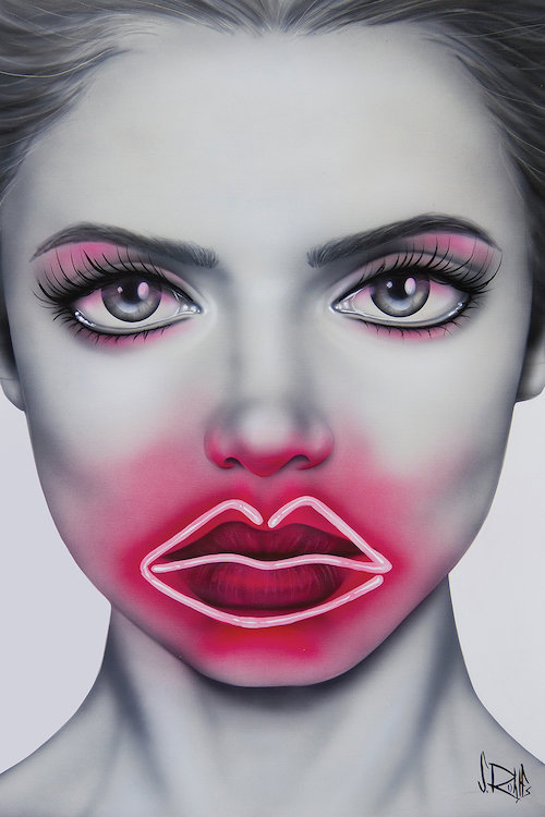 Portrait of a female face with her lips outlined in a pink neon light