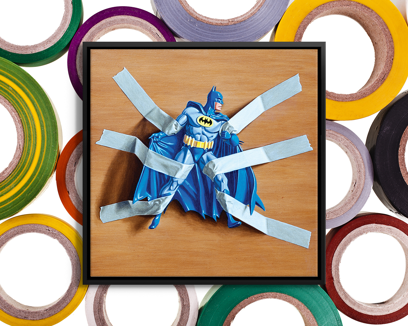Photo of blue Batman action figure taped to a wood surface with six pieces of tape