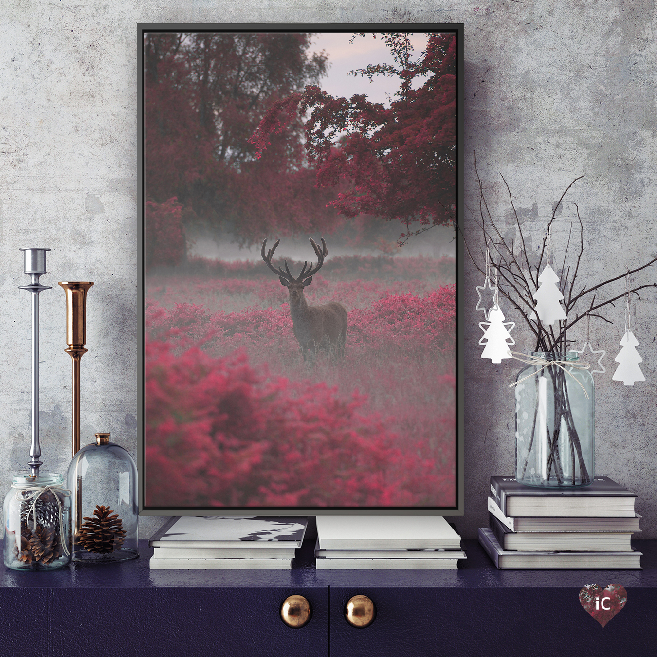 """""""Strawberry Stag I"""" by Max Ellis shows a stag standing in red fields under red trees."""