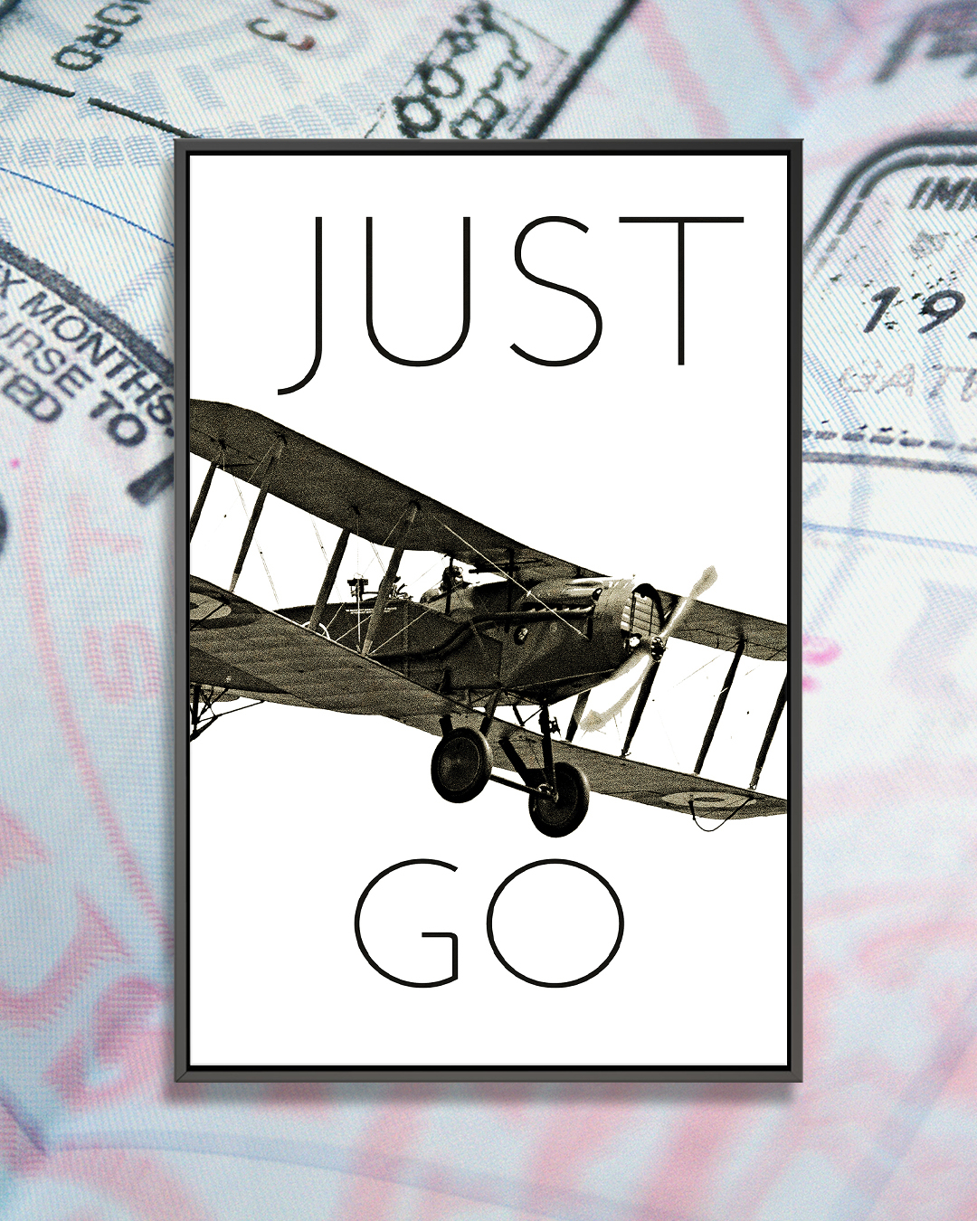 """""""Vintage Airplanes I"""" by Michael Marcon shows a black and white photo of an airplane flying through the words 'just go'."""