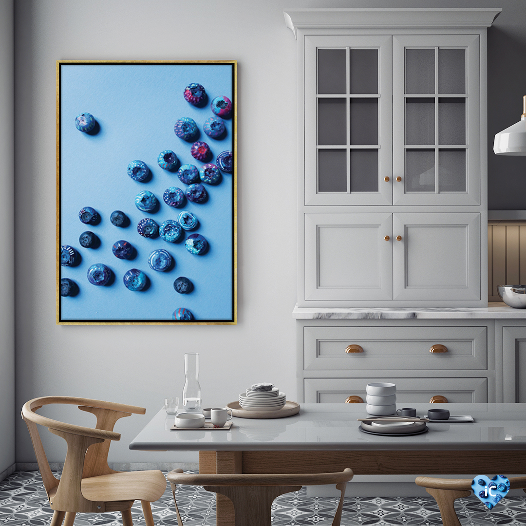 """Blueberries"" by ETTAVEE shows blueberries decorated with small white and pink accents against a blue background."