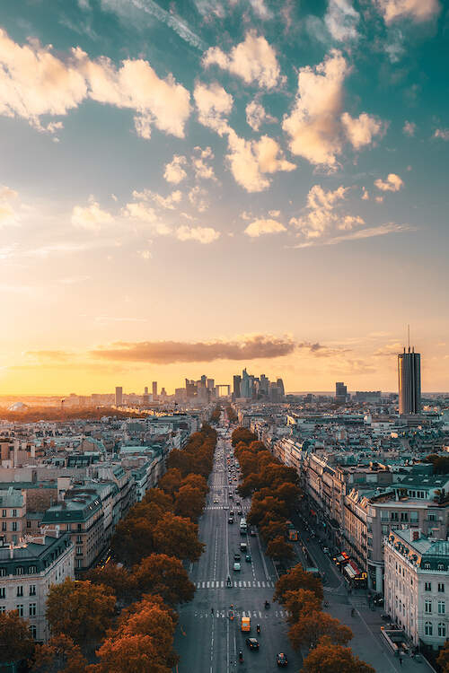 """""""Sunset In Paris"""" by Peter Yan shows a sunset over the buildings in Paris."""