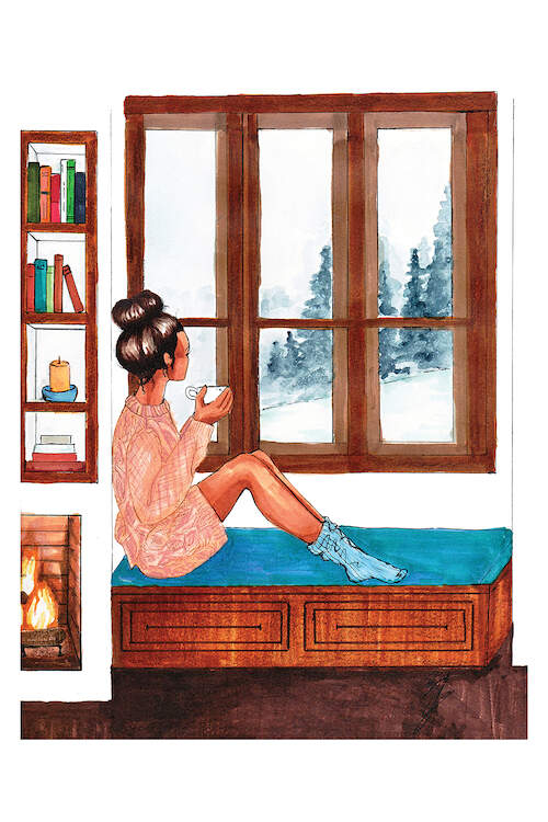"""""""Snowed In"""" by Brooke Ashley shows a woman holding a mug while gazing at a snow-covered forest as she sits on a window sill next to a fire."""