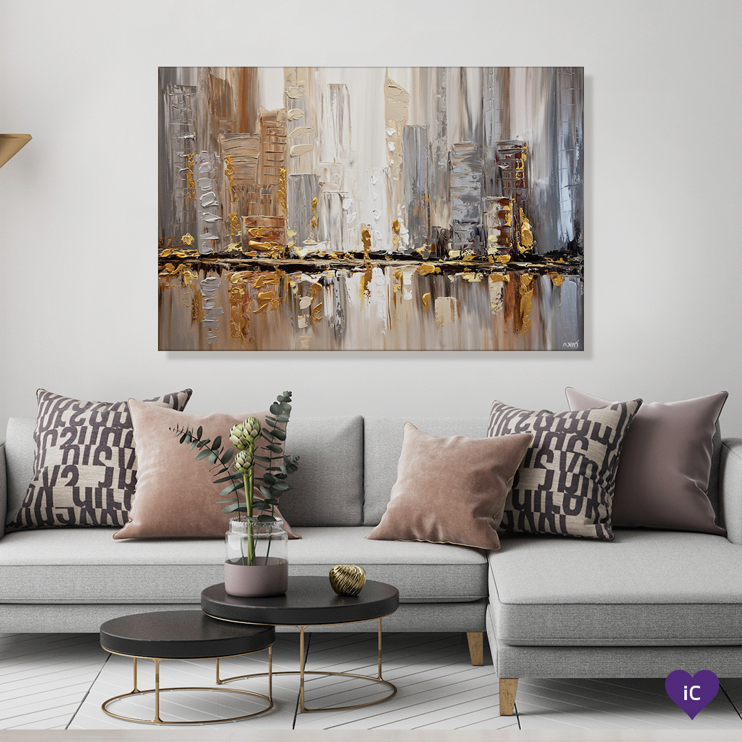 """""""Streets I"""" by Osnat Tzadok shows an abstraction of a city skyline against a water's edge using paint strokes in gold, gray, white, and brown"""